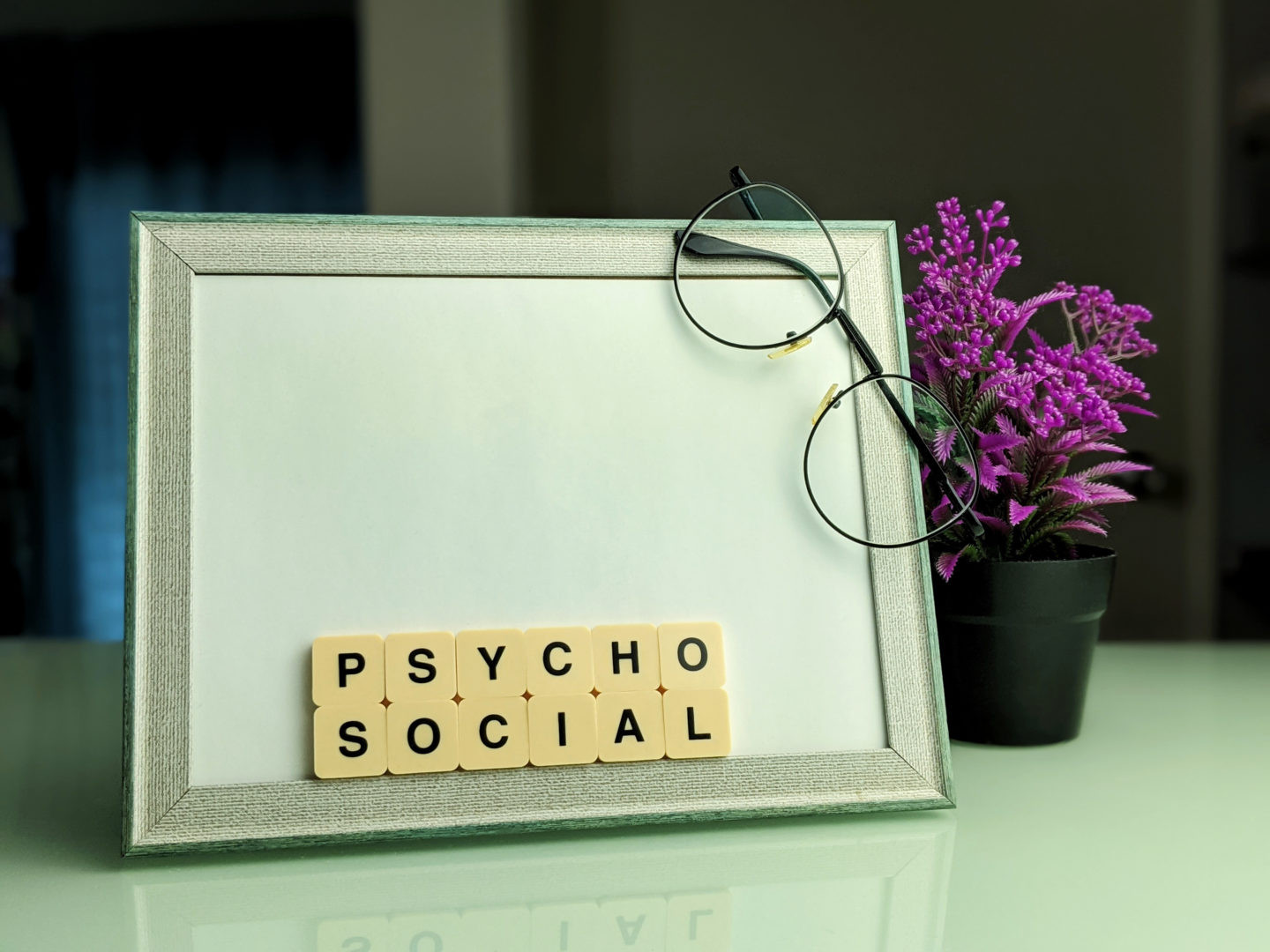 Alphabhet Pyshcosocial in the frame with a blur background