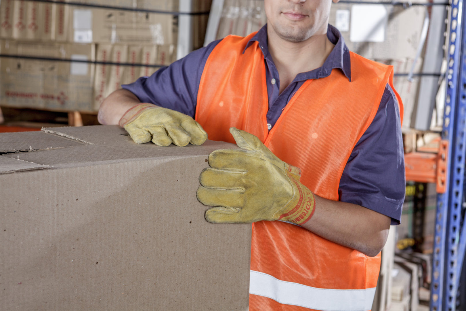 Workers In Warehouse Preparing Goods For shipping