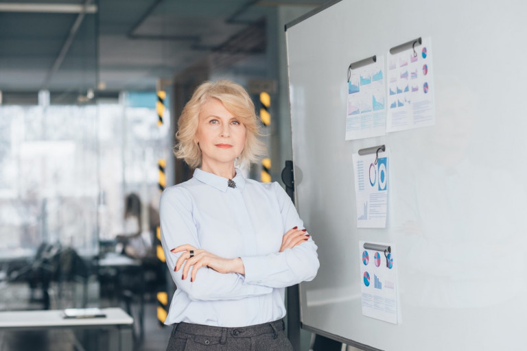 confident business woman arms folded top coach